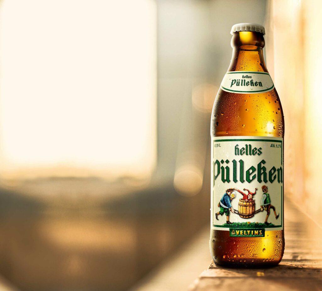 """""""Helles Pülleken"""" vermittelt Leichtigkeit und LebensfreudeMild-süffiges Hell-Bier mit humorvollem Charakter - Veltins-"""
