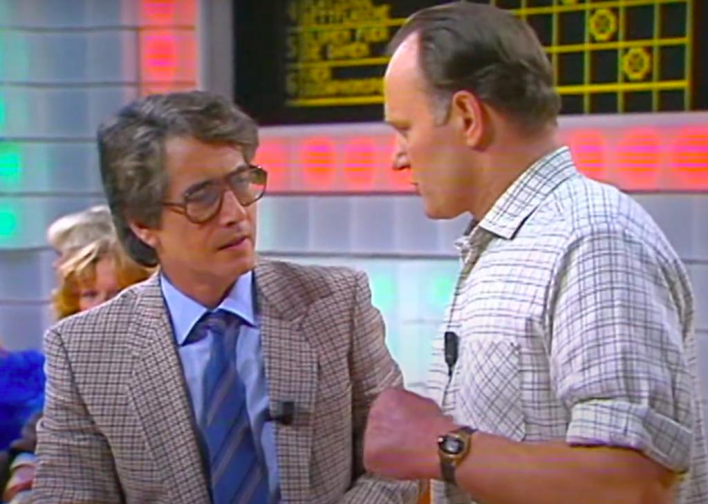 """Wie er auf die Idee gekommen sei, fragte Frank Elstner. Matthias Heuel: """"Heute sprechen sie alle vom Energiesparen. Da habe ich mir gedacht: Der Schmiedeberuf ist einer der ältesten Berufe, da musst Du auch einen Beitrag dazu leisten …"""" 1983 brachte es Matthias Heuel mit seiner gewonnenen Wette ins Guiness-Buch der Rekorde. (Screenshot)"""