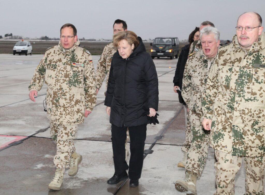 Volker Engelmann (l.) und Angela Merkel