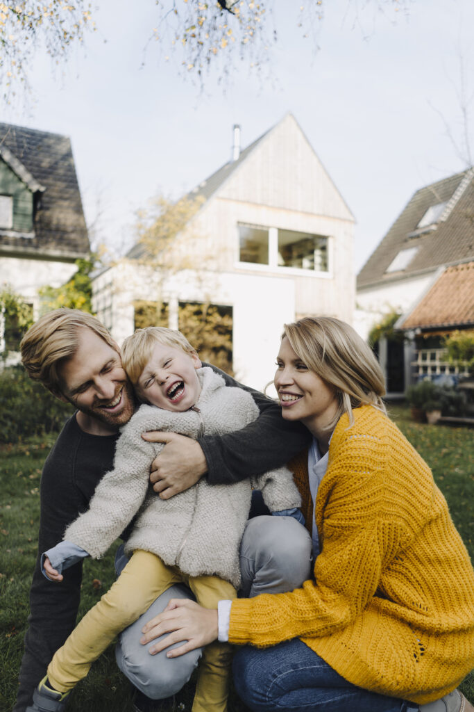 Happy affectionate family in garden